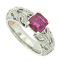 A stunning 1.27 carat, certified, square cut pink sapphire blooms in the center of this 14K white gold engagement ring