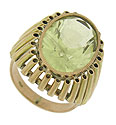 This unique 14K yellow gold estate ring is set with a fantastic oval cut lime quartz