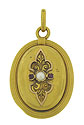 This elegant 18K yellow gold antique locket is adorned with a romantic floral design