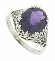 A breathtaking 3.32 carat amethyst is featured at the center of this 14K white gold engagement ring