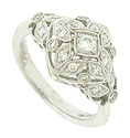 This 14K white gold engagement ring features a floral design