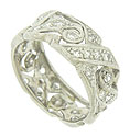 Fantastic diamond frosted organic cutwork spins across the surface of this antique platinum wedding band