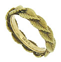 Layers of yellow gold leaves spin across the surface of this lovely 14K yellow gold wedding band