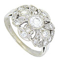 A brilliant .43 carat round cut diamond glows from the center of this breathtaking 14K white gold engagment ring