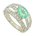 Ribbons of fine faceted diamonds stretch from the sides of this elegant 18K white gold ring to embrace a fabulous 2.50 carat sea foam colored beryl