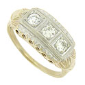 Spectacular round cut diamonds press into the surface of this 14K bi-color antique engagement ring