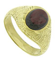 A deep red cabochon garnet is set into the center of this elegant 14K yellow gold antique ring