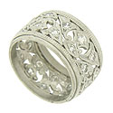 This exquisite antique platinum wedding band features a spectacular organic cutwork