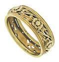Golden floral cutwork covers the surface of this romantic 14K yellow gold wedding band