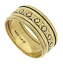 A ribbon of engraved abstract blossoms dances across the face of this handsome 14K yellow gold wedding band