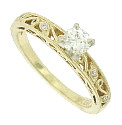 A glittering .33 carat, H color, Si clarity diamond rises above the surface of this 14K yellow gold engagement ring