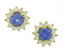 Dazzling, round cut tanzanite are surrounded by fine faceted diamonds on the face of these 14K yellow gold estate earrings