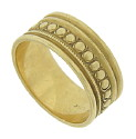 Layers of bold milgrain decoration and raised rib designs cover the surface of this 14K yellow gold wedding band