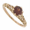 Fantastic 14K rose gold filigree covers the shoulders of this elegant antique style engagement ring