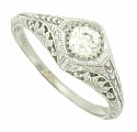 A brilliant .36 carat, H color, Si1 clarity diamond glows from the face of this spectacular 14K white gold engagement ring