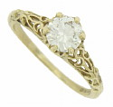 A breathtaking .65 carat, F color, Si2 clarity diamond is glows from the face of this 14K yellow gold engagement ring