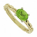 A fabulous .80 carat, oval cut peridot glows from the face of this elegant 14K yellow gold engagement ring