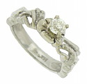 This elegant floral inspired engagement ring is set with a brilliant .35 carat, round cut diamond