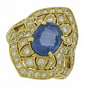 A glorious 3.26 carat, natural blue sapphire glows from the center of this spectacular antique style engagement ring