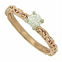A glorious .38 carat, H color, Si2 clarity diamond glows from the face of this elegant 14K rose gold engagement ring