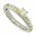 A brilliant .28 carat, G color, I3 clarity diamond is mounted above the surface of this elegant 14K bi-color engagement ring