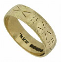 This 10K yellow gold antique wedding band is adorned with abstract organic engraving