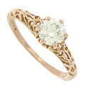 A glowing, brilliant .73, H color, Vs2 clarity diamond glows from the surface of this 14K rose gold engagement ring
