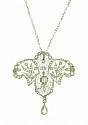This elegant antique platinum pendant features delicate floral filigree set with fine faceted diamonds