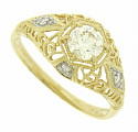 Fantastic floral inspired filigree covers the surface of this antique style engagement ring