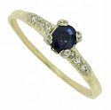 This handsome vintage engagement ring features a .36 carat round cut sapphire at its center