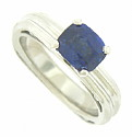 This elegant 14K white gold engagement ring is set with a 1.78 carat deep blue cushion cut sapphire