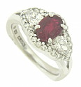 This 18K white gold engagement ring features a dazzling 1.36 carat oval cut ruby