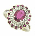 This fantastic floral inspired engagement ring features a 1 carat oval ruby