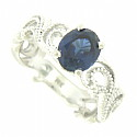 This romantic 14K white gold engagement ring is set with a fantastic 1.93 carat oval cut sapphire