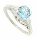 This romantic 14K white gold engagement ring is set with a glorious round cut aquamarine