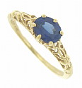 A .90 carat oval cut sapphire is set into the face of this 14K yellow gold engagement ring