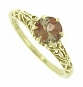A rich cocoa hued .80 carat andalucite is set into the face of this 14K yellow gold ring