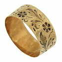 This antique 10K rose gold wedding band features an intricate floral design