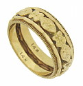 This elegant 14K yellow gold wedding band is adorned with layers of intricate engraving and floral decoration