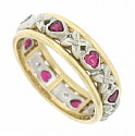 This romantic 14K bi-color wedding band features a  charming cutwork design of alternating delicate blooms and heart shaped rubies