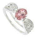 This breathtaking 14K antique style engagement ring features a fantastic oval cut pink tourmaline