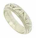 This elegant 14K white gold wedding band is engraved with organic decoration