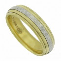 This classic 18K and platinum estate wedding band features a central band of platinum pressed into a layered 18K yellow gold band