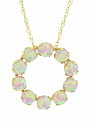 This elegant pendant fashioned of 10K yellow gold features a glowing ring of round opals
