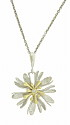 This antique style pendant features a 14K gold bi-color flower