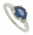 This romantic 14K white gold engagement ring is set with a 1.57 carat oval cut sapphire
