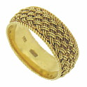 Delicate twisting strands of 18K yellow gold are woven in a continuous pattern on the surface of this estate wedding band
