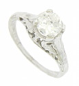 This breathtaking 14K white gold engagement ring is set with a GIA certified .96 carat, E colored, VSII round cut diamond