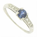 This elegant 14K white gold engagement ring is set with a .53 carat round cut sapphire