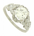 A GIA certified 1.42 carat, I color, Si1 clarity diamond glows from the face of this amazing antique platinum engagement ring